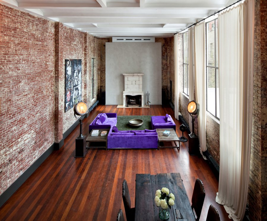 Businessinsiderthe Living Room Is Enormous The Purple Couches And Exposed  Brick Walls Give The Room A Nice Flair